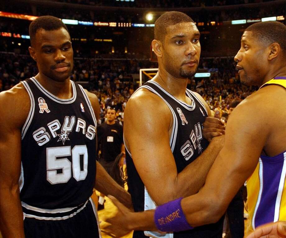 Tim Duncan and David Robinson and the Lakers\' Samaki Walker visit after their game Tuesday, May 14, 2002 at the Staples Center. Robinson was held scoreless as the Spurs lost the series.