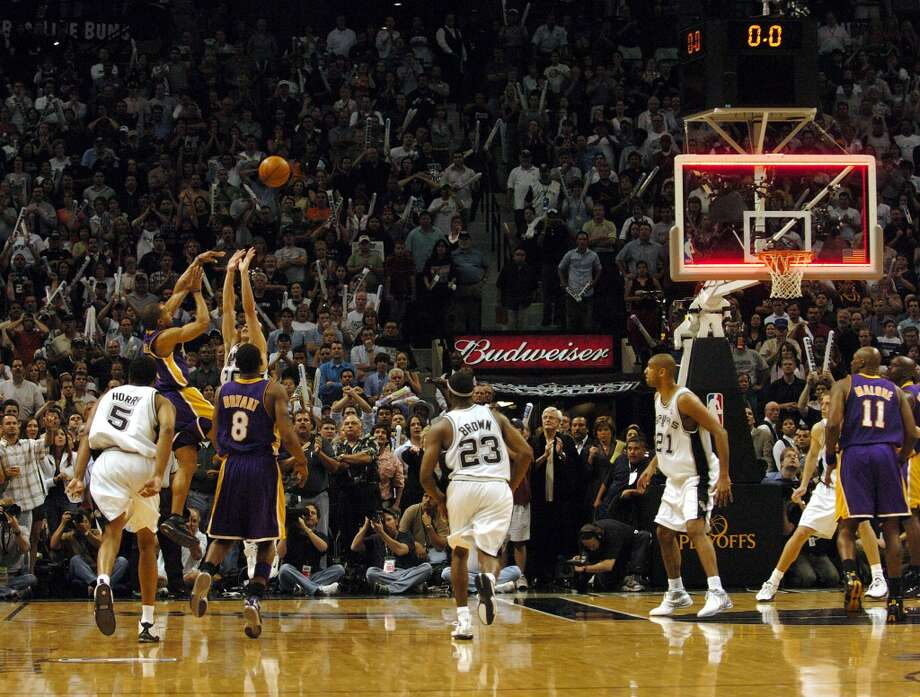 This might be the most painful second in Spurs history. The Lakers\' Derek Fisher launches the game winning shot as the clock runs out over the defense of the Spurs\' Manu Ginobili to win Game 5 74-73 in the Western Conference semifinals at the SBC Center on Thursday, May 13, 2004.