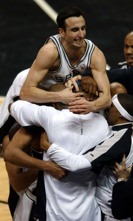 Spurs players mob Tim Duncan after he made a shot near the end of the game to put the Spurs up by 1 during the fourth quarter of the Spurs against the Lakers in Game 5 of the Western Conference semifinals at the SBC Center on Thursday, May 13, 2004. The Lakers went on to win 74-73.