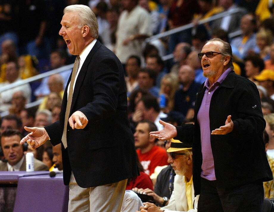 The Spurs saw their 2004 season end against the Lakers. Spurs coach Gregg Popovich yells instructions to the team as Jack Nicholson stands behind him during the game with the Lakers\' during Game 6 of the Western Conference semifinals in Los Angeles on Saturday, May 15 , 2004.