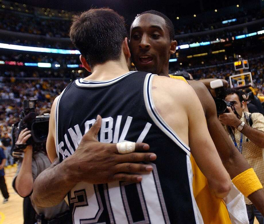 The Spurs\' Manu Ginobili hugs Lakers\' Kobe Bryant after Game 6 of the Western Conference semifinals at the Staples Center in Los Angeles on Saturday, May 15 , 2004. The Lakers went on to win.