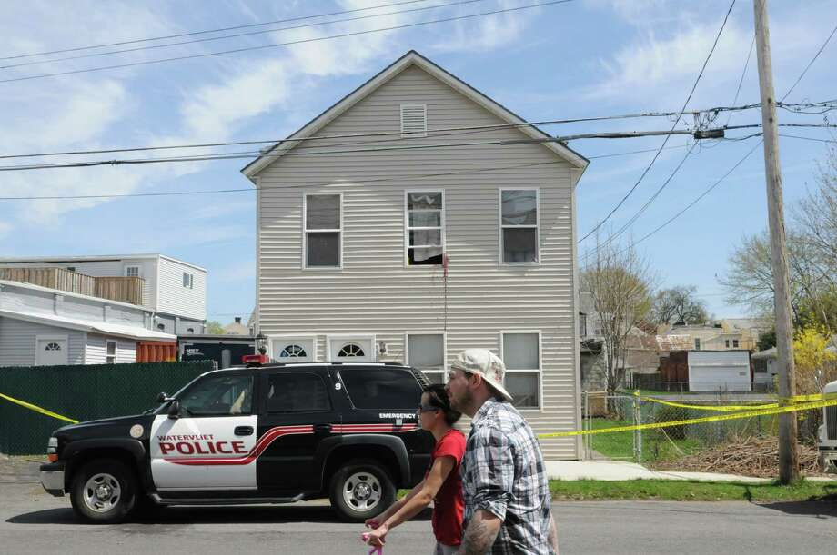 Scene of a homicide Monday afternoon, April 22, 2013, on 5th Avenue in Watervliet N.Y.  One man was killed and another hospitalized after a knife fight on Sunday.  Blood is visible from the second floor window. (Will Waldron/Times Union) Photo: Will Waldron