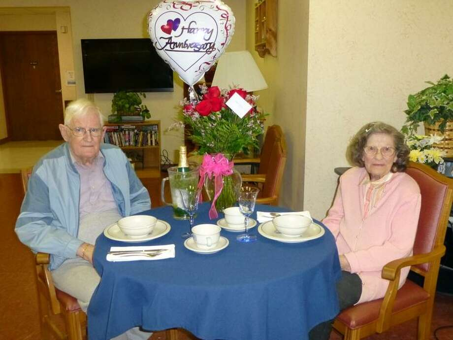 The Wesley Community residents Omar Herrick), 90, and his wife Gloria, 87, celebrate their 70th wedding anniversary with a dinner at Wesley Health Care Center in Saratoga Springs on April 10. Originally from Maine, the couple were high school sweethearts who wed in Portland, in 1943. A job transfer relocated the couple to South Glens Falls in 1971. After retiring to Florida for 27 years, the Herricks returned to South Glens Falls in 2009 before relocating to Wesley Health Care Center in August 2012. (submitted photo) Photo: Picasa