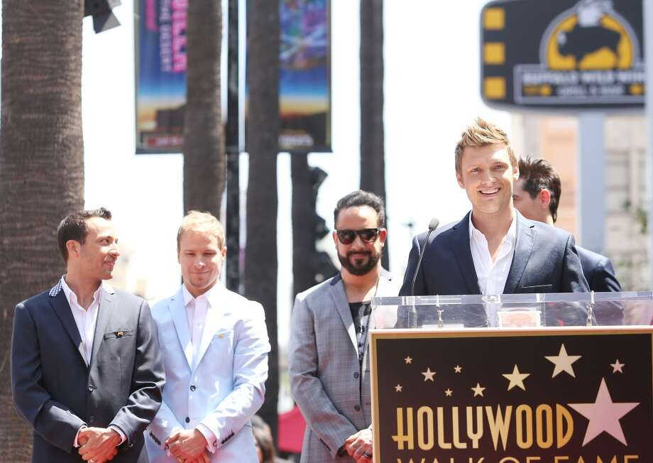 HOLLYWOOD, CA - APRIL 22:  AJ McLean, Nick Carter, Brian Littrell , Howie Dorough and Kevin Richardson of Backstreet Boys attend the ceremony honoring them with a Star on The Hollywood Walk of Fame held on April 22, 2013 in Hollywood, California.  (Photo by Michael Tran/FilmMagic)
