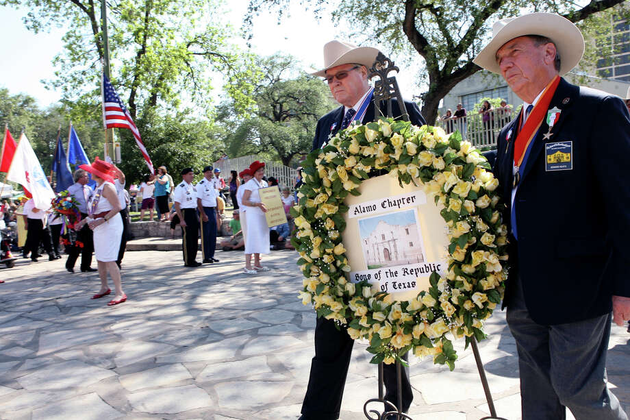 Members of the Sons of the Republic of Texas start walking toward the Alamo April 22, 2013 to put their wreath down during the Fiesta pilgrimage to the Alamo.  The event honors those that defended the Alamo. Photo: CYNTHIA ESPARZA, For The San Antonio Express-News / SAN ANTONIO EXPRESS-NEWS