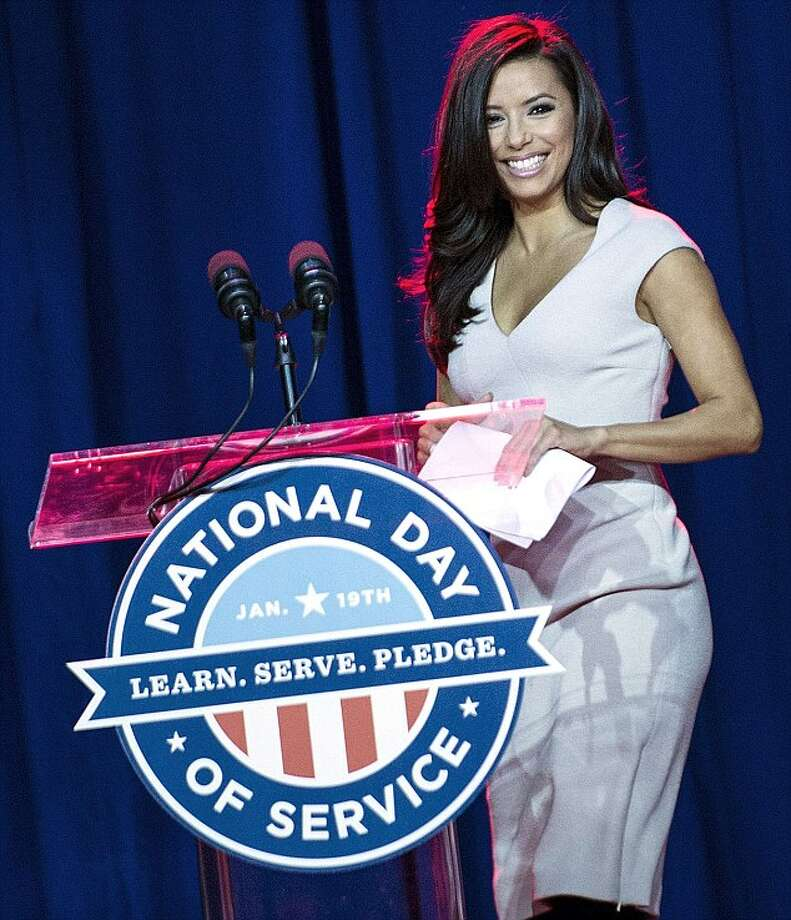 Presidential Inaugural Committee Co-Chair Eva Longoria dons an elegant white figure-flattering dress to speak at a service summit on the National Mall, January 19, 2013 in Washington, DC. As part of the 57th Presidential Inauguration, Americans across the country will participate in service projects in their communities to celebrate the legacy of civil rights leader Dr. Martin Luther King, Jr. Photo: BRENDAN SMIALOWSKI , AFP/Getty Images / AFP