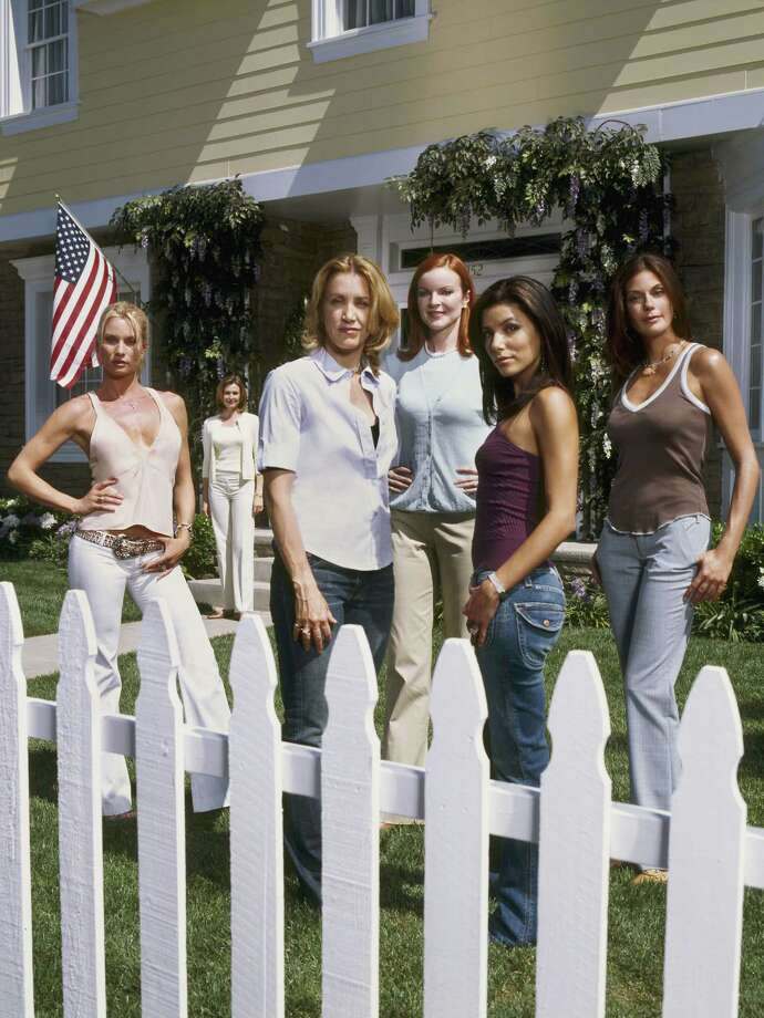 "A primetime soap with a truly contemporary take on ""happily every after,"" this new hour- long drama takes a darkly comedic look at suburbia, where the secret lives of housewives aren't always what they seem. ""Desperate Housewives"" stars (from left) Nicollette Sheridan as Edie Britt, Felicity Huffman as Lynette Scavo, Marcia Cross as Bree Van De Kamp, Eva Longoria as Gabrielle Solis, Teri Hatcher as Susan Mayer and Brenda Strong (background) as Mary Alice Young. Photo: MOSHE BRAKHA, ABC / ABC, INC."
