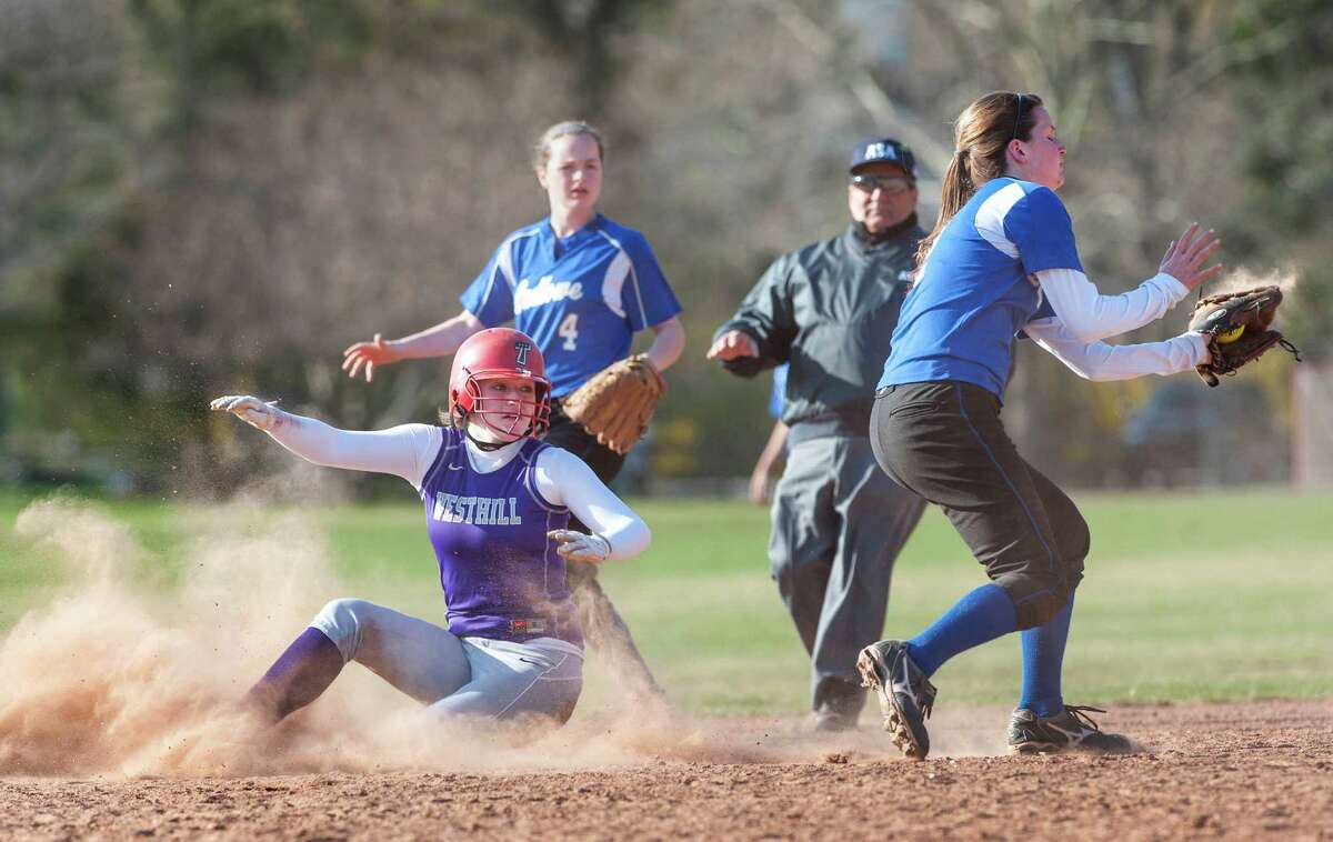 Fairfield Ludlowe high school shortstop Emily Nelson doesn't get the throw in time so Westhill high school's Tammy Wise slides safely into second during a softball game played at Sturges Field, Fairfield, CT on Monday April 22nd, 2013.