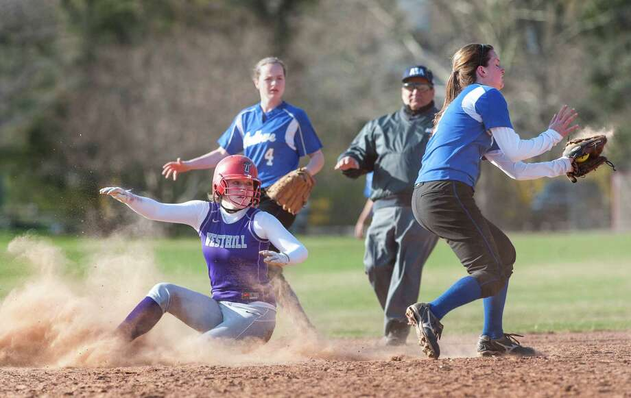 Fairfield Ludlowe high school shortstop Emily Nelson doesn't get the throw in time so Westhill high school's Tammy Wise slides safely into second during a softball game played at Sturges Field, Fairfield, CT on Monday April 22nd, 2013. Photo: Mark Conrad / Connecticut Post Freelance