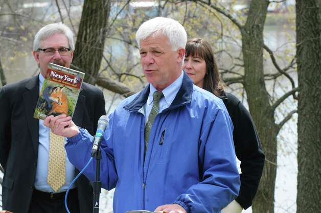DEC Commissioner Joe Martens, center, holds a copy of the New York Wildlife Viewing Guide during an event to launch New York?s Watchable Wildlife Program Monday, April 22, 2013, at Peebles Island State Park in Waterford, N.Y.  The guide features more than 100 wildlife viewing locations. (Will Waldron/Times Union) Photo: Will Waldron