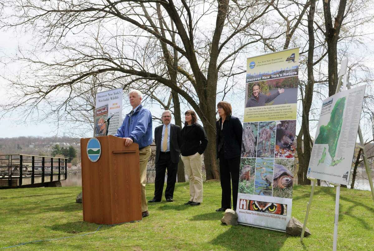 DEC Commissioner Joe Martens, left, spoke during an event to launch New York?s Watchable Wildlife Program Monday, April 22, 2013, at Peebles Island State Park in Waterford, N.Y. The New York Wildlife Viewing Guide, which features more than 100 wildlife viewing locations, was also announced. (Will Waldron/Times Union)