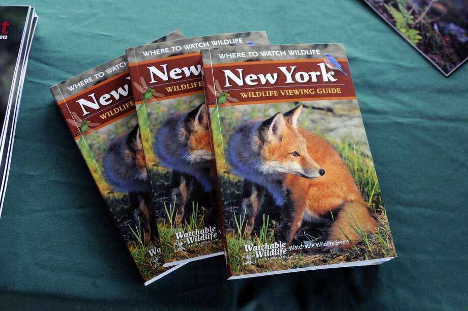 Copies of the New York Wildlife Viewing Guide, which features more than 100 viewing locations, Monday, April 22, 2013, at Peebles Island State Park in Waterford, N.Y. DEC Commissioner Joe Martens announced the launch of New York?s Watchable Wildlife Program, which included the new Wildlife Viewing Guide. (Will Waldron/Times Union) Photo: Will Waldron