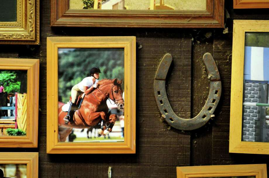 An old horseshoe is on display with a group of competition photos on Tuesday, April 9, 2013, at Van Lennep Riding Center in Greenfield,  N.Y. (Cindy Schultz / Times Union) Photo: Cindy Schultz / 10021904A