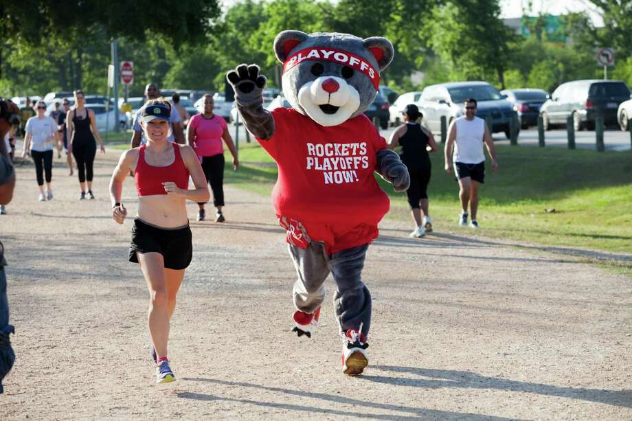 "Rockets mascot Clutch (Robert Boudwin) is trying to inspire the team during its playoff run with a run of his own. Clutch the Rockets Bear will be running a 5K every day of the first round series to live up to the team motto ""younger, faster, fearless."" Find out about the 5K cause and the man behind the bear at houstonchronicle.com.  Photo: Eric Kayne, For The Chronicle / © 2013 Eric Kayne"