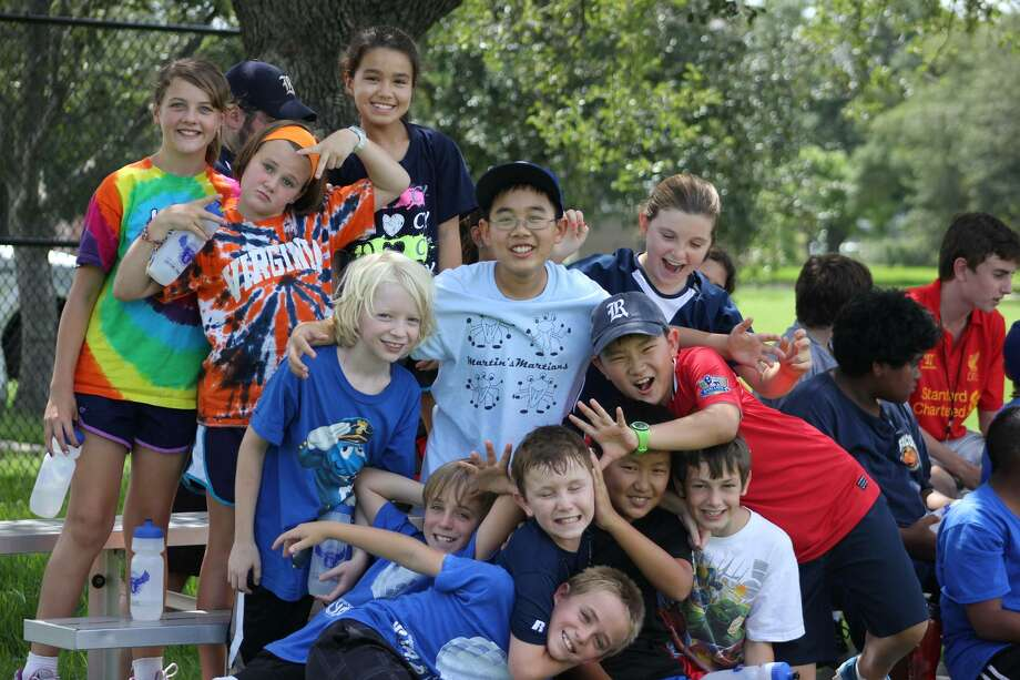 Campers gather for a group photo at one of SYAP's camp programs.