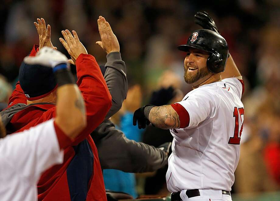 BOSTON, MA - APRIL 22:  Mike Napoli #12 of the Boston Red Sox celebrates with teammates after he connected for a grand slam in the fifth inning against the Oakland Athletics at Fenway Park on April 22, 2013 in Boston, Massachusetts.  (Photo by Jim Rogash/Getty Images) Photo: Jim Rogash, Getty Images