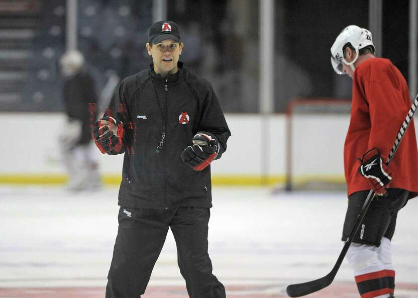 Coach Rick Kowalsky talks to his players during the Albany Devils hockey practice at the Times Union