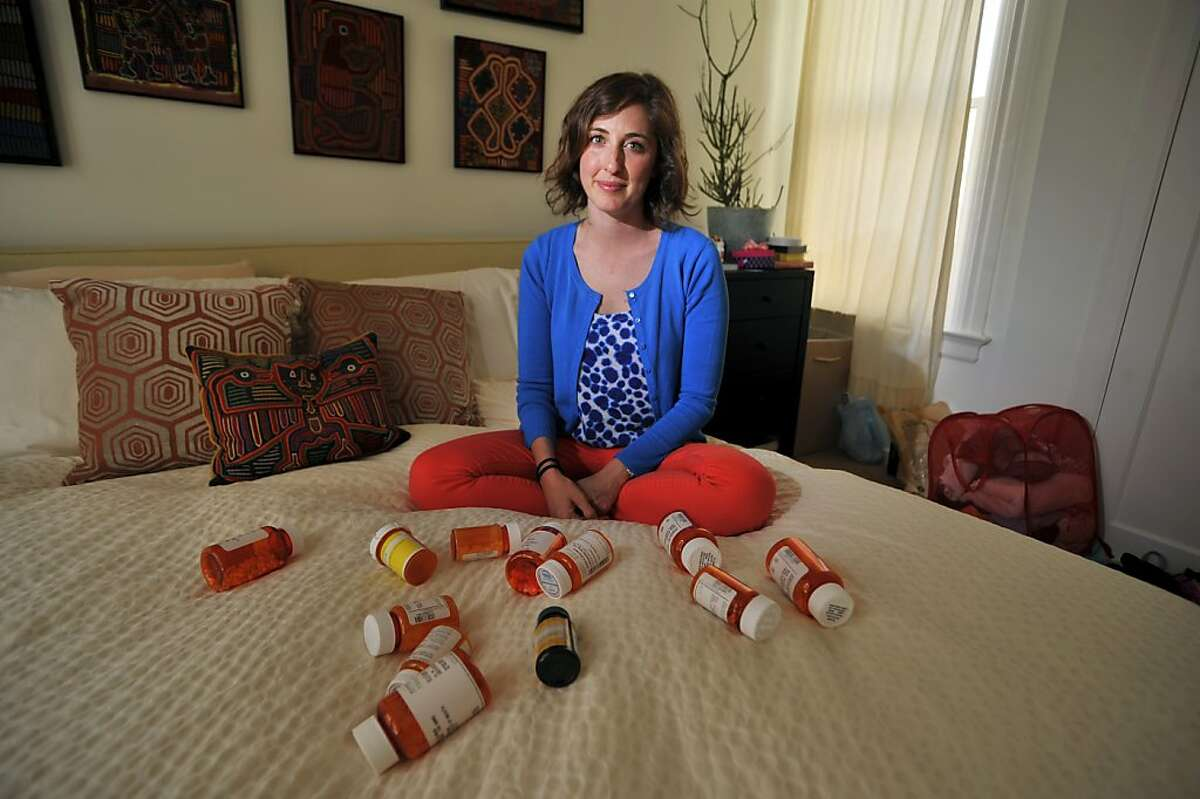 Jessica Foung shows some of the drugs she takes after surviving kidney failure.