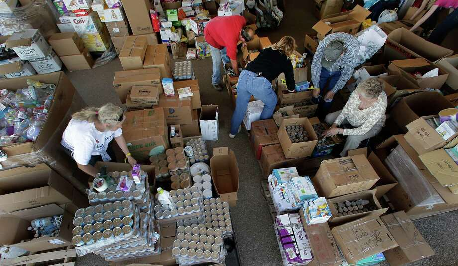 Volunteers sort through donated goods in West on Monday. Photo: Charlie Riedel, Associated Press / AP