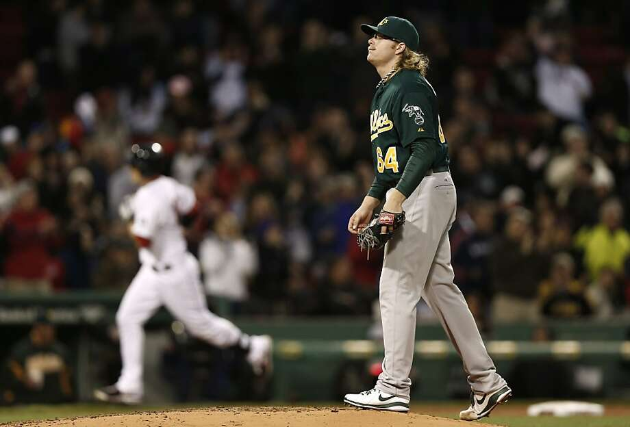 A.J. Griffin walks on the mound after giving up a three-run home run to the Red Sox's Will Middlebrooks, rear. Photo: Winslow Townson, Associated Press