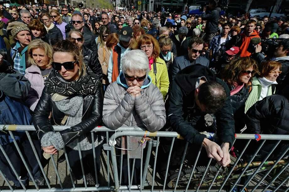 People observe a moment of silence near the Boston Marathon finish line, one week after the bombings. Photo: Kevork Djansezian, Getty Images
