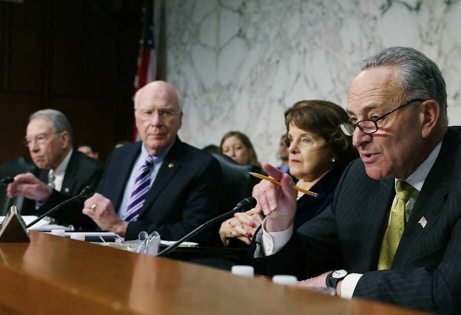 Sens. Charles Schumer, D-N.Y., (far right) and Charles Grassley, R-Iowa, (far left) were the principals in a heated exchange on immigration reform related to the Boston bombings. Photo: Getty Images