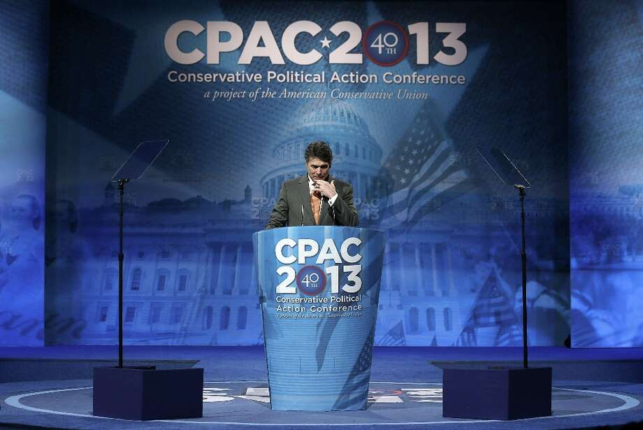 NATIONAL HARBOR, MD - MARCH 14:  Texas Gov. Rick Perry addresses the 40th annual Conservative Political Action Conference (CPAC) March 14, 2013 in National Harbor, Maryland. A slate of important conserative leaders are slated to speak during the the American Conservative Union's annual conference.  (Photo by Alex Wong/Getty Images) Photo: Alex Wong, Getty Images / 2013 Getty Images