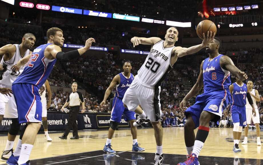Spurs' Manu Ginobili (20) gets fouled while driving into the lane against Los Angeles Clippers' Blake Griffin (32) and DeAndre Jordan (06) in the first quarter at the AT&T Center on Friday, Mar. 29, 2013. Manu left the game with a hamstring condition and did not return for the game. Photo: Kin Man Hui, San Antonio Express-News