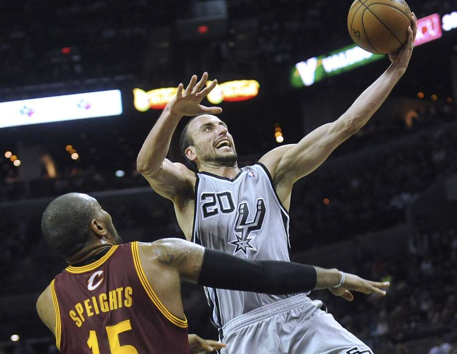 Manu Ginobili of the Spurs drives past Marreese Speights of the Cleveland Cavaliers during NBA action at the AT&T Center on Saturday, March 16, 2013. Photo: Billy Calzada, San Antonio Express-News