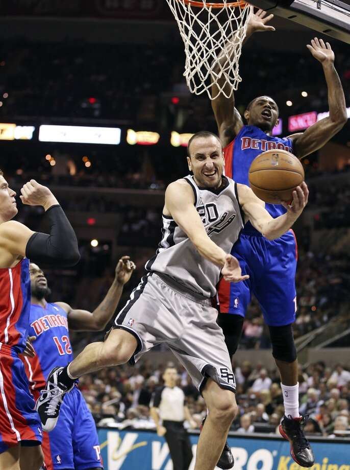 San Antonio Spurs' Manu Ginobili passes between Detroit Pistons' Jonas Jerebko (from left), Detroit Pistons' Will Bynum and Detroit Pistons' Brandon Knight during second half action Sunday March 3, 2013 at the AT&T Center. The Spurs won 114-75. Photo: Edward A. Ornelas, San Antonio Express-News