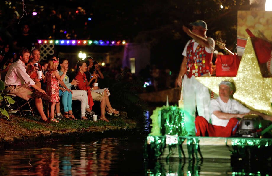 "Spectators watch the TEAMability's ""All Stars"" float pass during the Texas Cavaliers River Parade ""Stars on the River"" held Monday April 22, 2013. Photo: Edward A. Ornelas, San Antonio Express-News / © 2012 San Antonio Express-News"