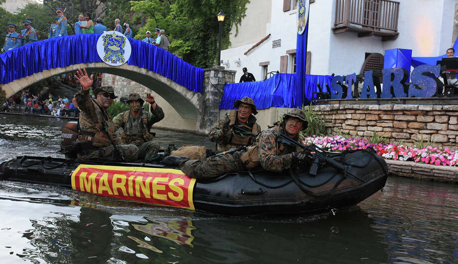 "Members of the United States Marine Corps 4th Reconnaissance Battalion pass through the Arneson River Theatre during the Texas Cavaliers River Parade ""Stars on the River"" held Monday April 22, 2013. Photo: Edward A. Ornelas, San Antonio Express-News / © 2012 San Antonio Express-News"