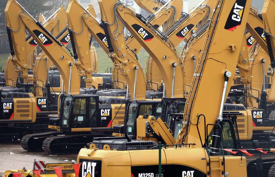 A Caterpillar Belgium lot in Gosselies brims with equipment. Caterpillar employed 141,000 at the end of the first quarter, down 7 percent from a year earlier. Photo: Yves Logghe, STF / AP