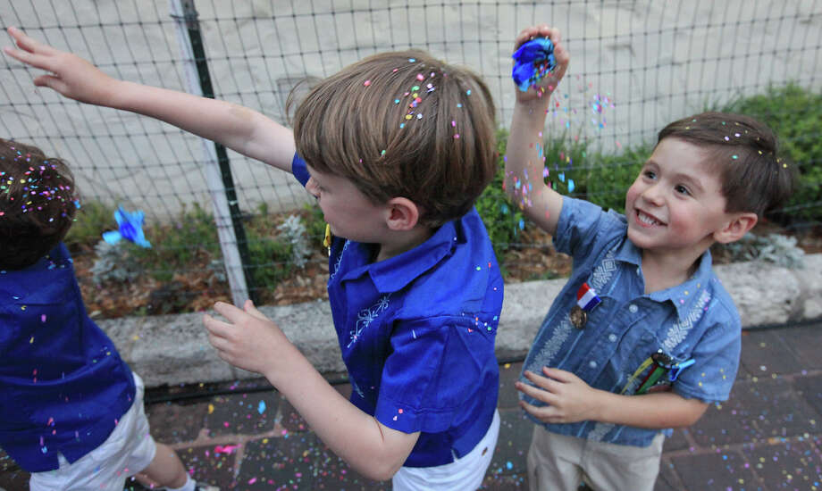 "Antonio Serna, 4, (right) cracks a cascarone on Spencer Smith, 6, while attending the Texas Cavaliers River Parade ""Stars on the River"" held Monday April 22, 2013. Photo: Edward A. Ornelas, San Antonio Express-News / © 2012 San Antonio Express-News"