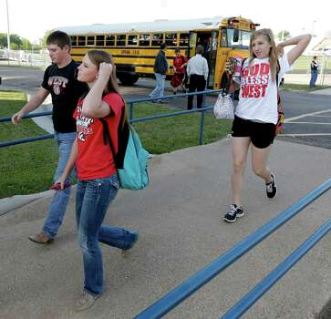 High school students from West, Texas arrive for classes at a temporary facility provided by the Connally Independent School District Monday, April 22, 2013, in Waco, Texas. West students returned back  to class today after a massive explosion at the West Fertilizer Co. five days ago damaged three of West's four schools, killed 14 people and injured more than 160 others. (AP Photo/Charlie Riedel) Photo: Charlie Riedel, STF / AP