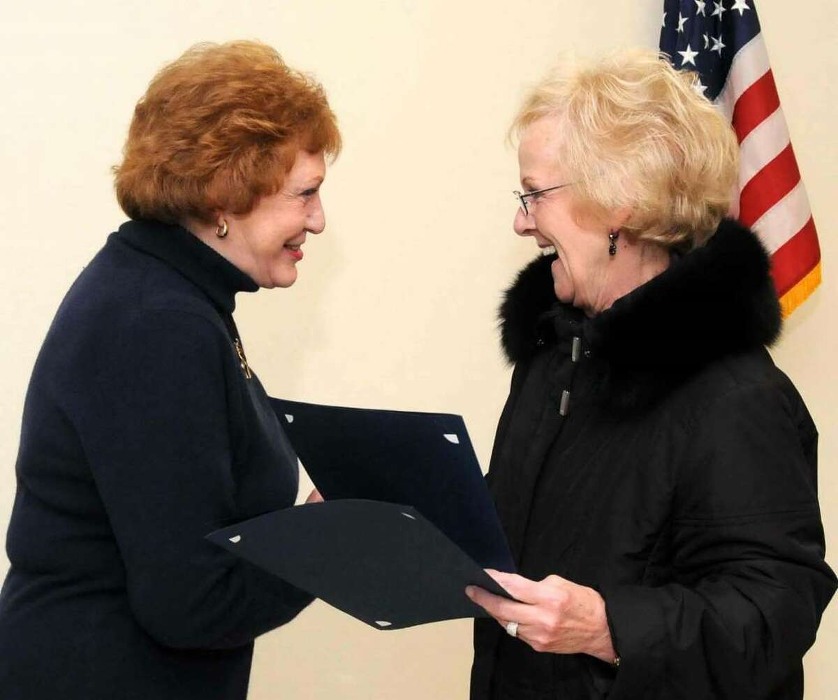 Carol Mattegat, left, retired from the Newtown Police Commission and was honored by the commission and First Selectman Pat Llodra at the Police Commissioner meeting Tuesday Jan. 5, 2010. The meeting took place at the Newtown Town Hall South.