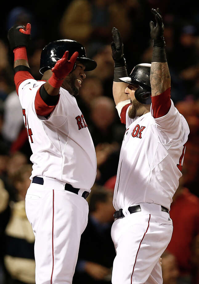 Boston Red Sox's Mike Napoli, right, celebrates his grand slam with teammate David Ortiz during the fifth inning of a baseball game against the Oakland Athletics at Fenway Park in Boston on Monday, April 22, 2013. (AP Photo/Winslow Townson) Photo: Winslow Townson