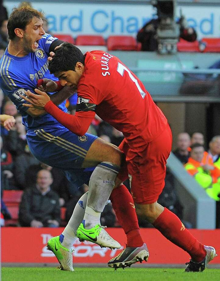 Liverpool's Luis Suarez, right, was fined for biting Chelsea defender Branislav Ivanovic on Sunday. Photo: ANDREW YATES, Stringer / AFP