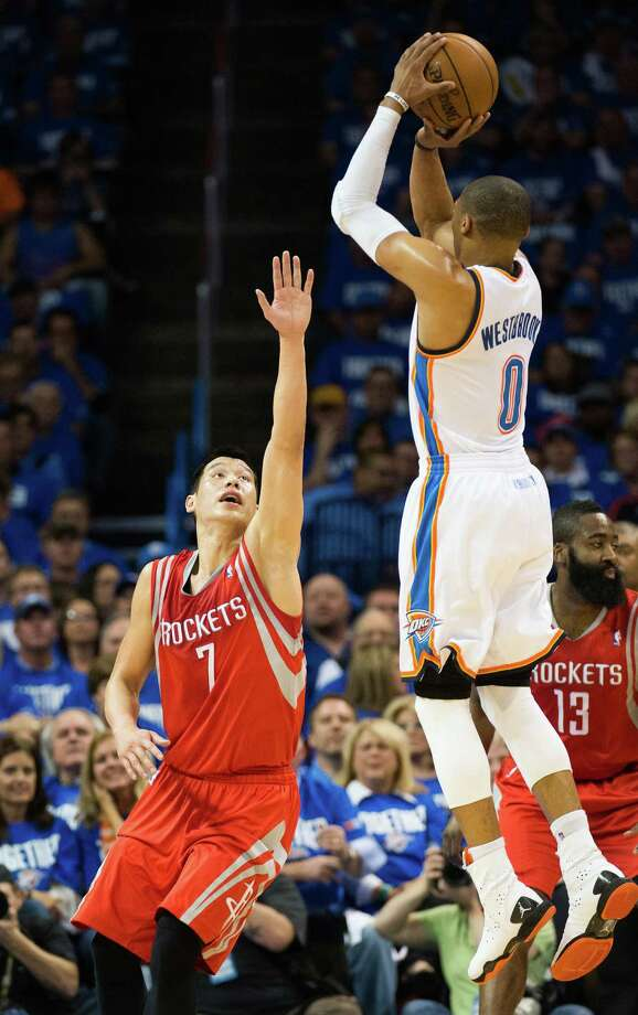 The Rockets mounted about as much of a challenge to the Thunder as Jeremy Lin did to Russell Westbrook's shot on this play Sunday night. Photo: Smiley N. Pool, Staff / © 2013  Houston Chronicle