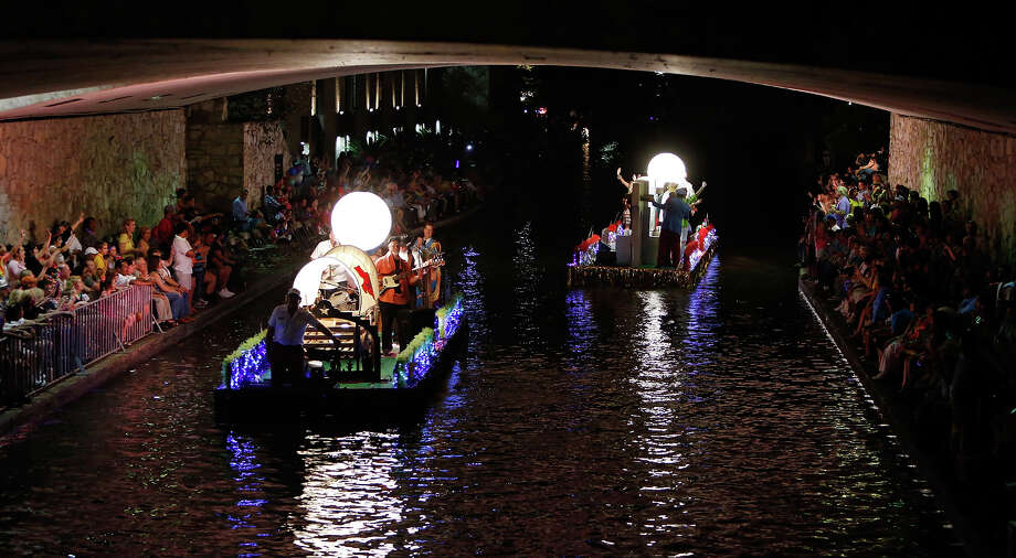"Floats pass under South Alamo Street during the Texas Cavaliers River Parade ""Stars on the River"" held Monday April 22, 2013. Photo: San Antonio Express-News / © 2012 San Antonio Express-News"