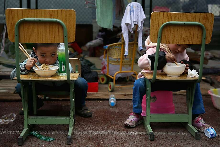CHENGDU, CHINA - APRIL 22:  Two earthquake survivors eat instant noodles outside the tent in a middle school on April 22, 2013 in Baoxing county of Ya An, China.  A magnitude 7 earthquake hit China's Sichuan province on April 20 claiming over 190 lives and injuring thousands.  (Photo by Feng Li/Getty Images) *** BESTPIX *** Photo: Feng Li, Getty Images