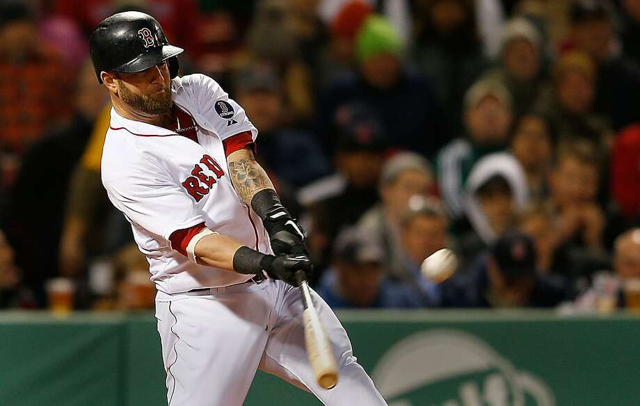 BOSTON, MA - APRIL 22:  Mike Napoli #12 of the Boston Red Sox connects for a grand slam in the fifth inning against the Oakland Athletics at Fenway Park on April 22, 2013 in Boston, Massachusetts.  (Photo by Jim Rogash/Getty Images) ***BESTPIX*** Photo: Jim Rogash, Getty Images