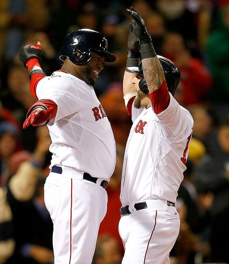 BOSTON, MA - APRIL 22:  Mike Napoli #12 of the Boston Red Sox celebrates with David Ortiz #34 of the Boston Red Sox after Napoli connected for a grand slam in the fifth inning against the Oakland Athletics at Fenway Park on April 22, 2013 in Boston, Massachusetts.  (Photo by Jim Rogash/Getty Images) ***BESTPIX*** Photo: Jim Rogash, Getty Images