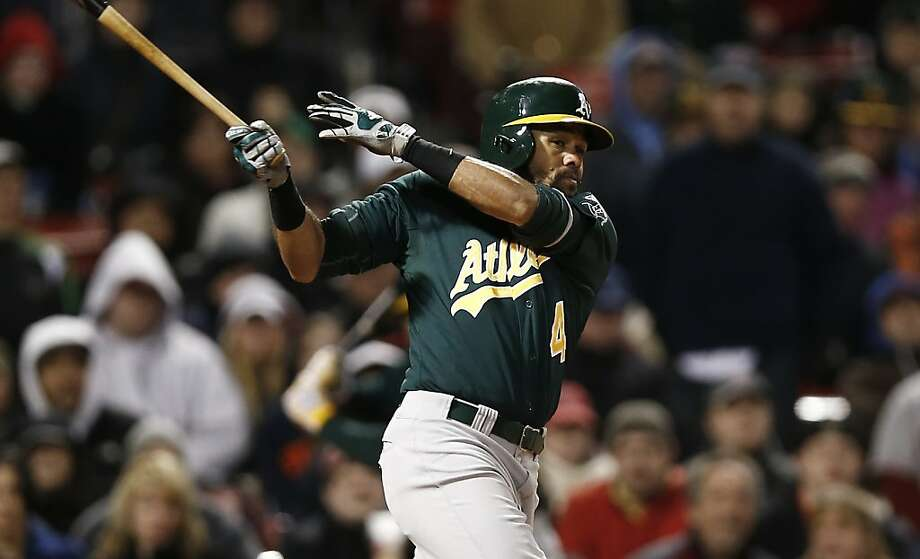 Oakland Athletics' Coco Crisp follows through against the Boston Red Sox during the eighth inning of a baseball game at Fenway Park in Boston Monday, April 22, 2013. (AP Photo/Winslow Townson) Photo: Winslow Townson, Associated Press