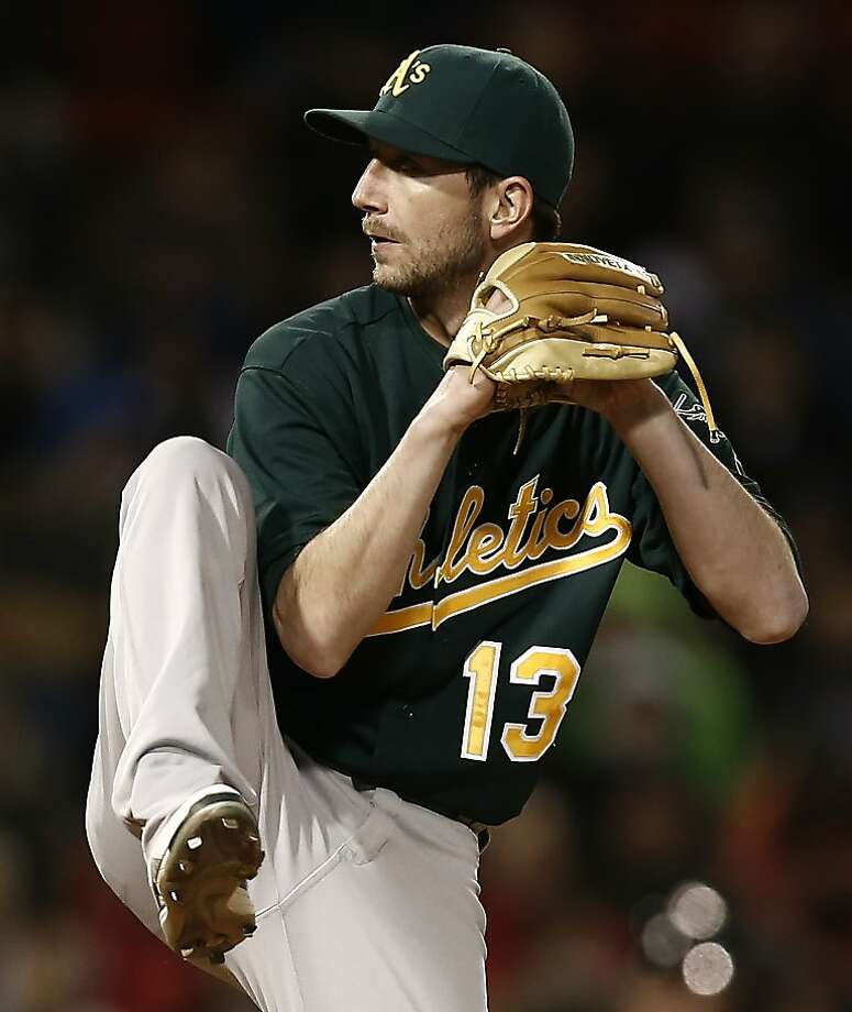 Oakland Athletics relief pitcher Jerry Blevins winds up against the Boston Red Sox during the sixth inning of a baseball game at Fenway Park in Boston Monday, April 22, 2013. (AP Photo/Winslow Townson) Photo: Winslow Townson, Associated Press