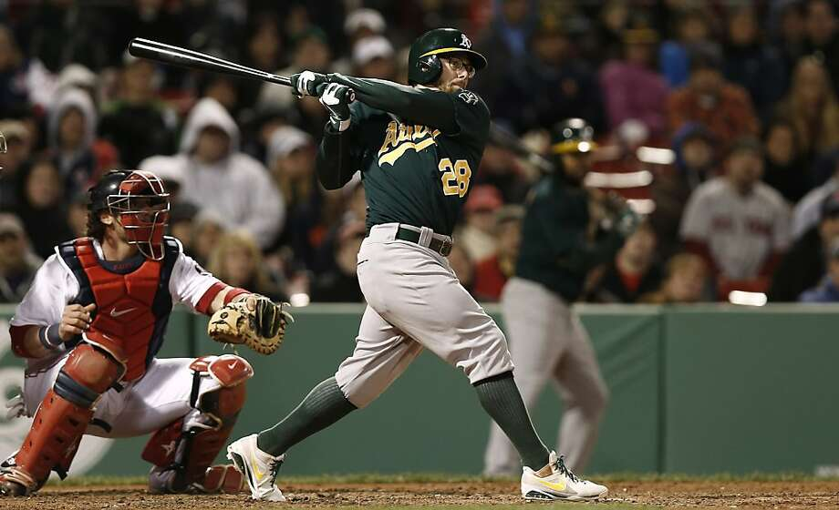 Oakland Athletics' Eric Sogard follows through against the Boston Red Sox during the eighth inning of a baseball game at Fenway Park in Boston Monday, April 22, 2013. (AP Photo/Winslow Townson) Photo: Winslow Townson, Associated Press