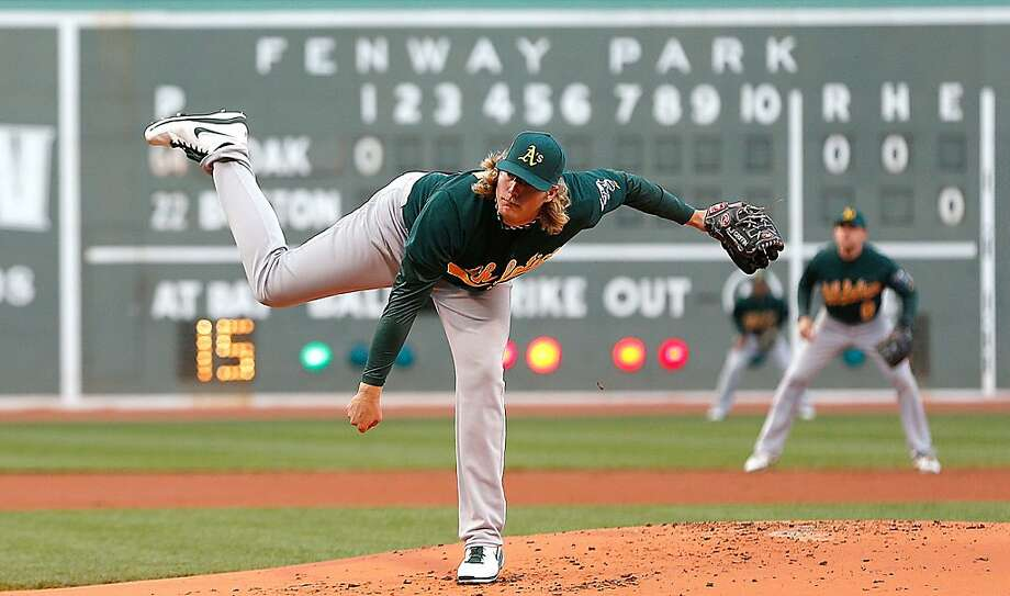 BOSTON, MA - APRIL 22:  A.J. Griffin #64 of the Oakland Athletics throws against the Boston Red Sox throws in the 1st inning at Fenway Park on April 22, 2013 in Boston, Massachusetts.  (Photo by Jim Rogash/Getty Images) Photo: Jim Rogash, Getty Images