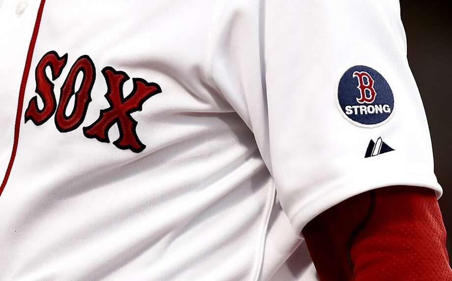 Boston Red Sox players wear a B Strong patch during the fourth inning of a baseball game against the Oakland Athletics at Fenway Park in Boston Monday, April 22, 2013. (AP Photo/Winslow Townson) Photo: Winslow Townson, Associated Press