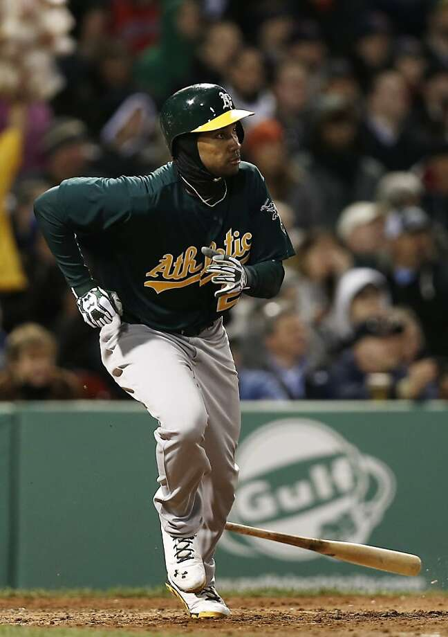 Oakland Athletics' Chris Young watches a hit against the Boston Red Sox during the fifth inning of a baseball game at Fenway Park in Boston Monday, April 22, 2013. (AP Photo/Winslow Townson) Photo: Winslow Townson, Associated Press