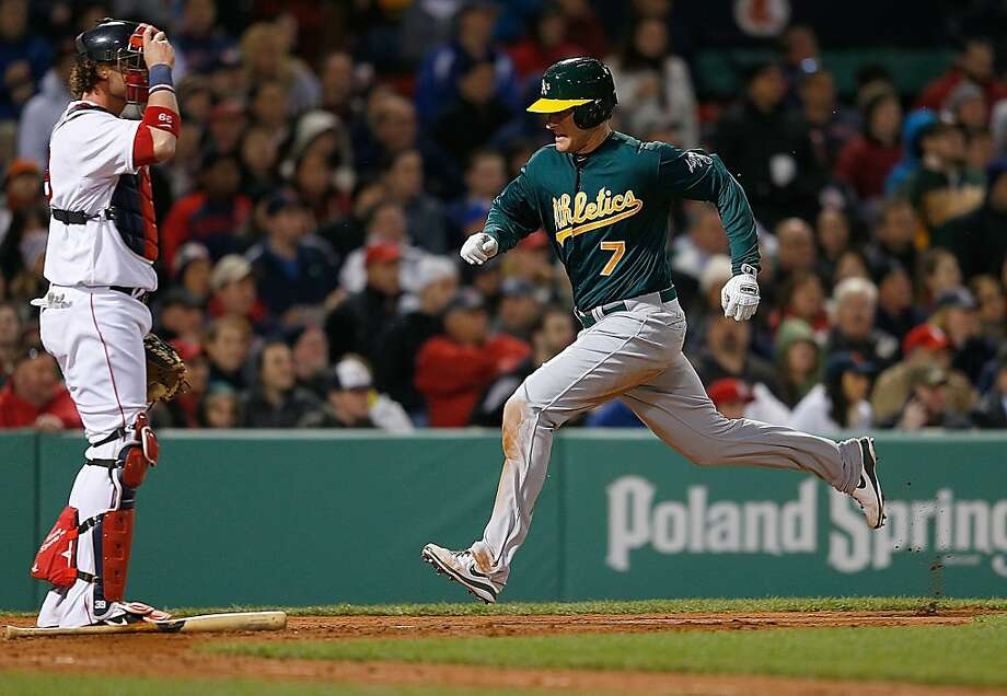 BOSTON, MA - APRIL 22:  Nate Freiman #7 of the Oakland Athletics scores a run by Jarrod Saltalamacchia #39 of the Boston Red Sox on a sacrifice fly in the 5th inning at Fenway Park on April 22, 2013 in Boston, Massachusetts.  (Photo by Jim Rogash/Getty Images) Photo: Jim Rogash, Getty Images